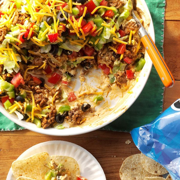 Ground Beef Taco Dip Recipe -Beef up your snack game with this meaty taco dip. Full of classic flavors, it's a little extra satisfaction for those football-day appetites. —Errika Perry, Packers Women's Association, Green Bay, Wisconsin