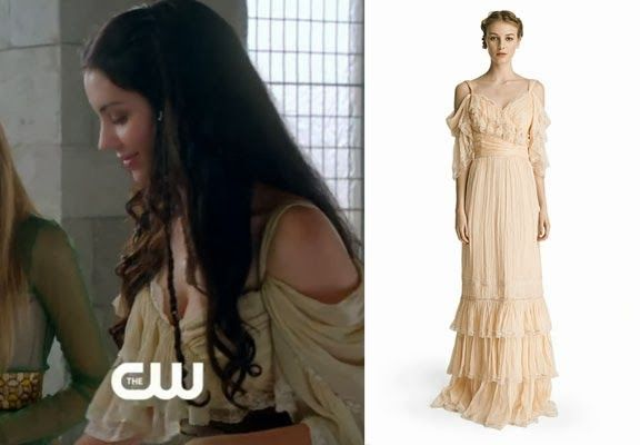 Mary Queen of Scots (Adelaide Kane) wears this silk chiffon off the shoulder dress with lace trim and tiers of ruffles in this week's episod...