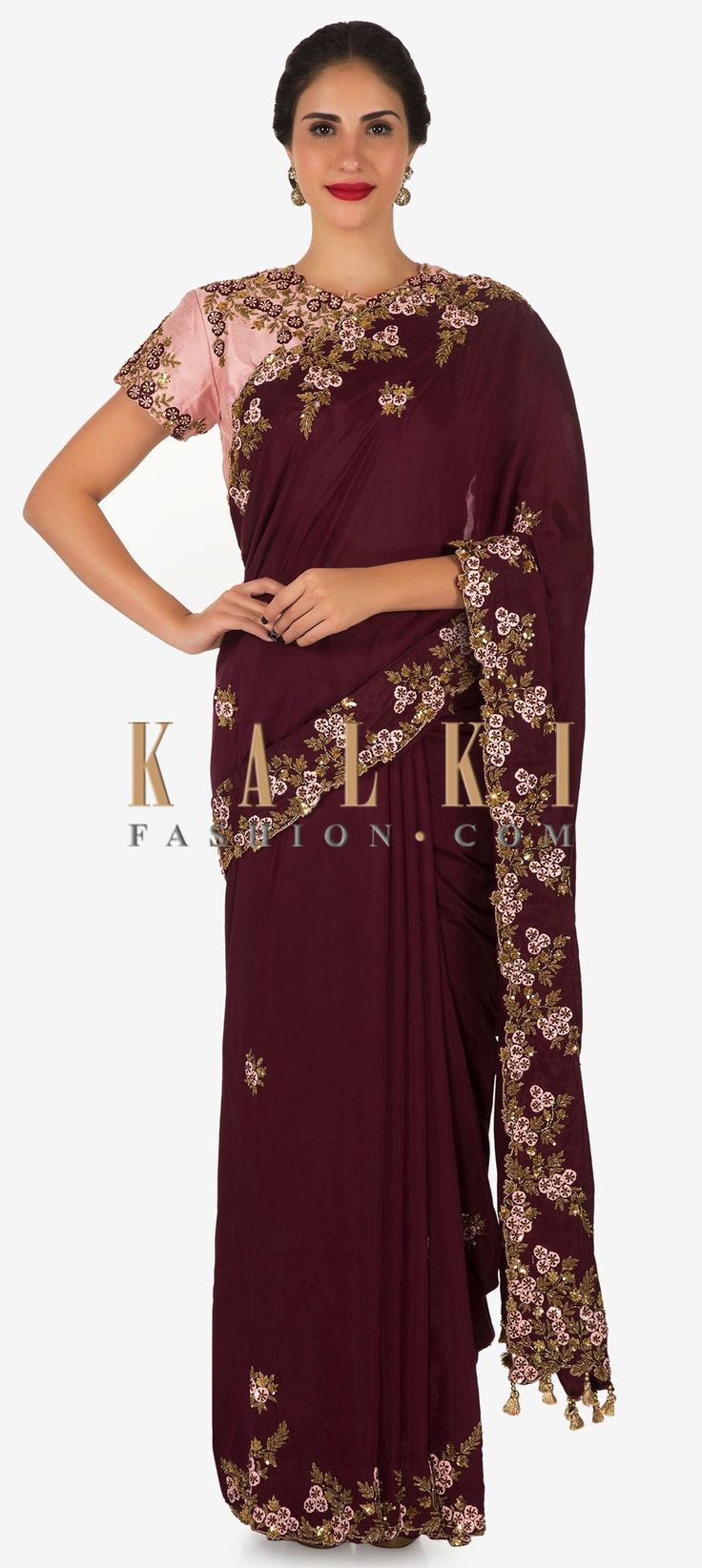 Buy Online from the link below. We ship worldwide (Free Shipping over US$100)  Click Anywhere to Tag Maroon saree with ready blouse in pink embroidered with resham and sequin work only on Kalki Maroon saree is featured in cotton silk fabric. The saree is beautifully decorated with resham and zardosi embroidered borders with scattered sequins. The saree pallav has attached tassels at the hem. Matched with a ready stitched blouse in pink.
