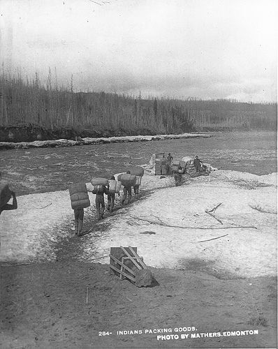 Aboriginal people portaging goods, Slave River, NT, about 1900