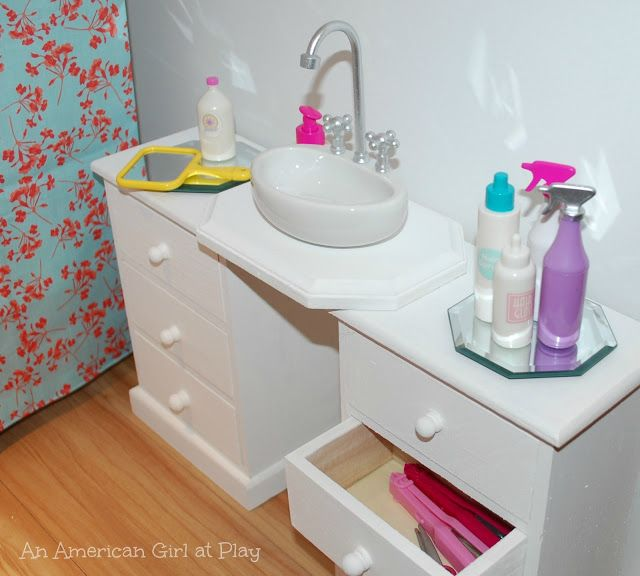 An American Girl at Play -- bathroom sink made out of magnet holder [sink] from Target stationary section and wooden drawers from JoAnn.
