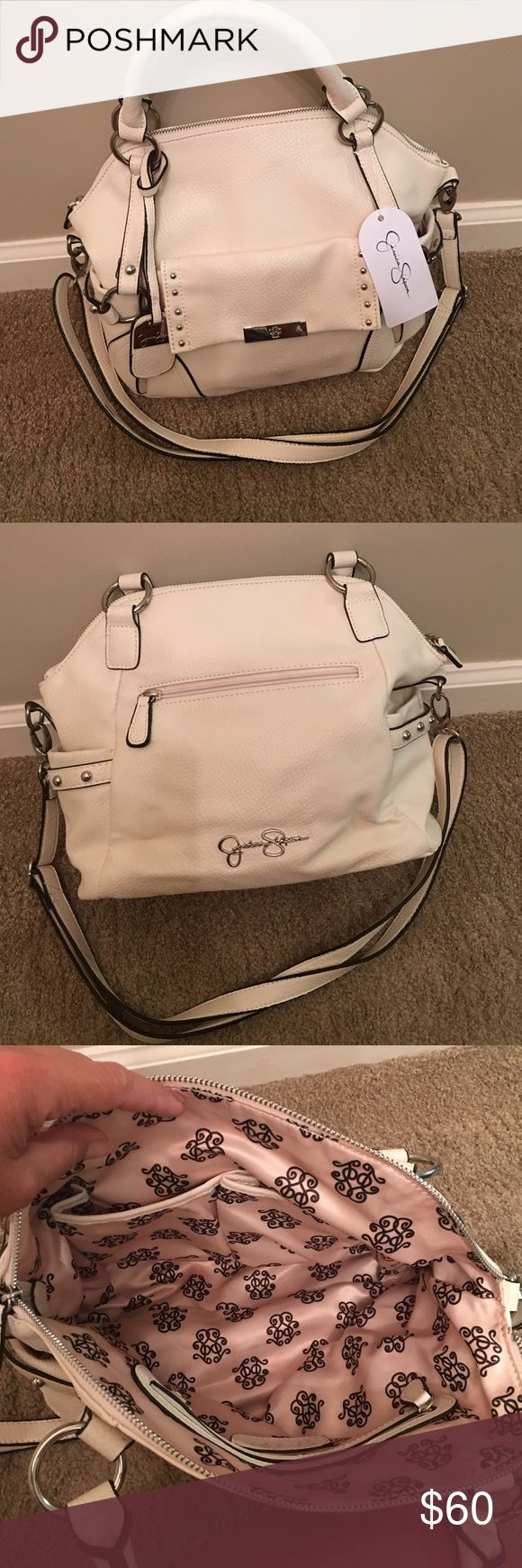 Jessica Simpson purse Cream in color, 4 pockets on outside, 3 inside. Jessica Simpson Bags Shoulder Bags