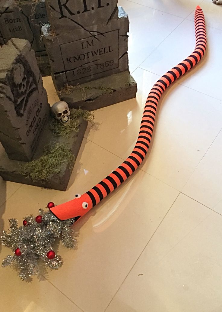 Nightmare before Christmas worm. 2 pool noodles, 1 pair tights, wreath garland and small red balls. Pom eyes and fun foam mouth.