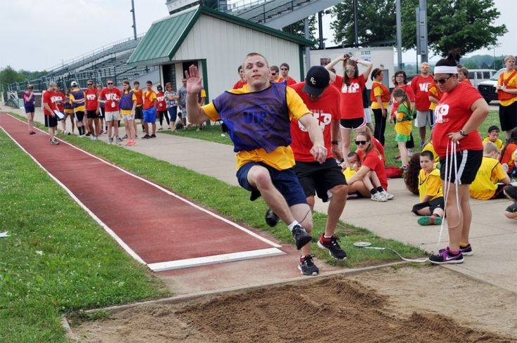 News story on a VIP Sports program that gives students with visual impairments sports and recreation opportunities. (image: a student participating in a long jump competition)