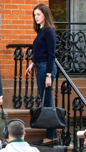 Anne Hathaway wearing Celine Box Flap Bag, STROM Brand Nio High Rise Skinny Jeans in Storm, STROM Brand Tio Storm Jeans and Cartier Tank Solo Watch