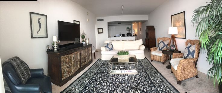 Navy and white living room, white sofa, white couch, antique tv stand, sea grass chair, navy and white rug, mirrors coffee table