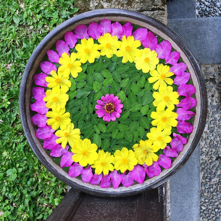 A Mandala flower arrangement shows balance in visual forms which symbolizes unity and harmony.
