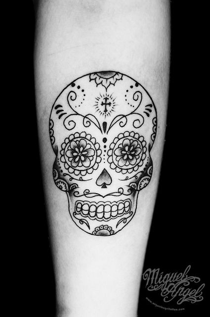 I don't get why people get freaked out by sugar skull tattoos...it's a skull, which is part of you, and they are decorated beautifully. To me it symbolizes the beauty of the human body.