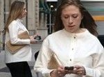 Pregnant Chelsea Clinton shows off her baby bump with husband Marc Mezvinsky in NYC