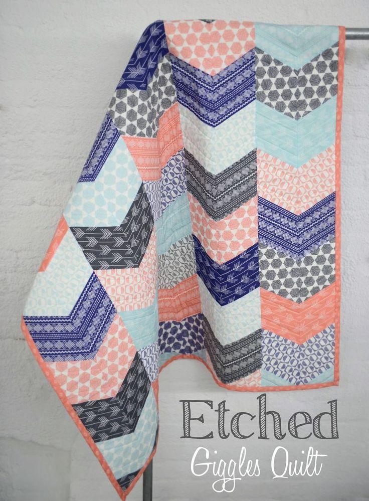 As the name implies, we had lots of fun putting together this quilt! We just knew this Giggles pattern from Jaybird would offer a great way to play up the directional nature of our Etched fabrics. We