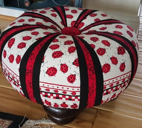 """Tuffet Source Pattern with Fusible Foundation Other supplies needed include 1 yard of muslin, 12 Add-a-Quarter Ruler and 64 2""""x21"""" strips of fabric, OR 8 Fat Quarters. Also need the Tuffet Kit to comp"""