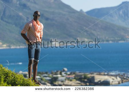http://www.shutterstock.com/pic-226382386/stock-photo-african-black-man-standing-on-a-high-rock-overlooking-cape-town-as-he-points-and-scouts-the-blue.html?src=WuffEuvvGWj02MQSGcnIHQ-1-17 African Black Man, Standing On A High Rock Overlooking Cape Town As He Points And Scouts The Blue Sky, Ocean And Mountains On A Sunny Summers Day Stock Photo 226382386 : Shutterstock