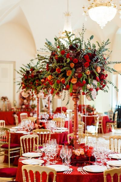 Wedding centerpieces with red, peach and dark red roses.
