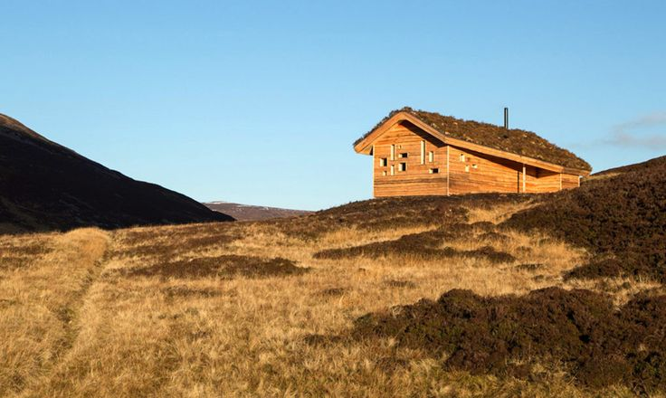 Culardoch Shieling hut is nestled in the Scottish Highlands and covered with heather, moss and stone gathered from local hillsides.