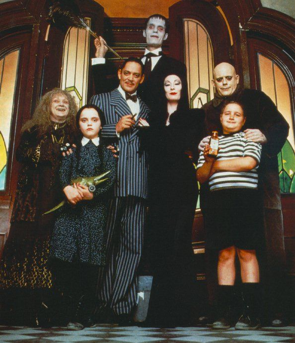 "The Addams Family (movie version, though the TV series came first). Other films that would make good Hallowe'en costumes because they're famous, though not really ""fashion"": The Munsters (similarly, a TV show first), scI-fi (Barbarella, Star Trek, Star Wars, The Rocky Horror Picture Show), fantasy (Mary Poppins, any Disney animation), Rocky, Shaft, Tom Cruise in ""Risky Business"", Men in Black."