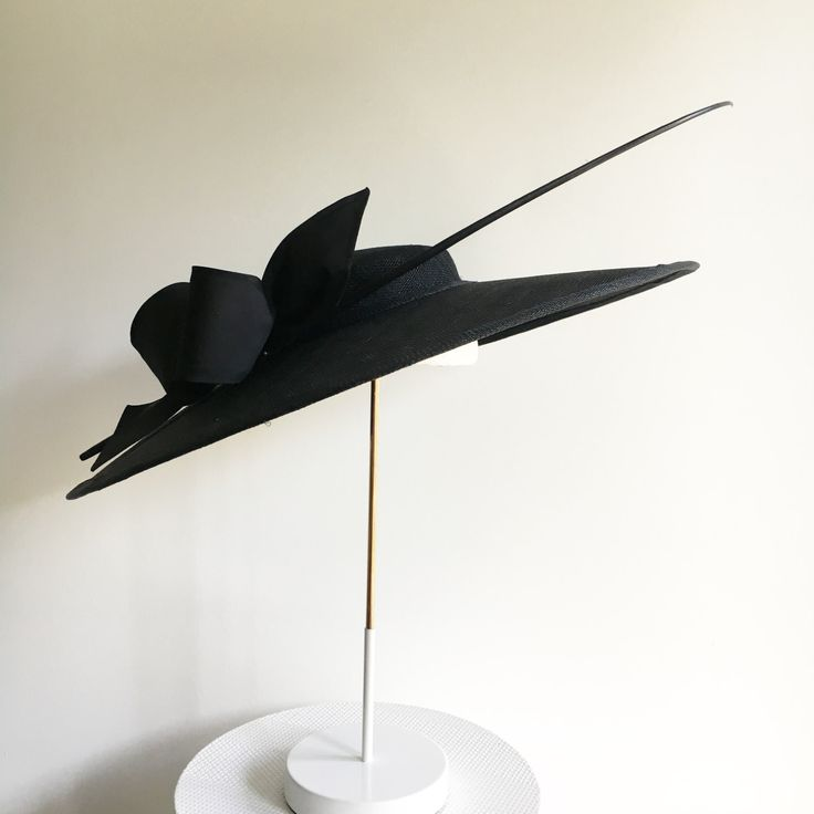 Elegant, all black wide brimed hat with matching quil and silk bow by RachelHenryMillinery on Etsy