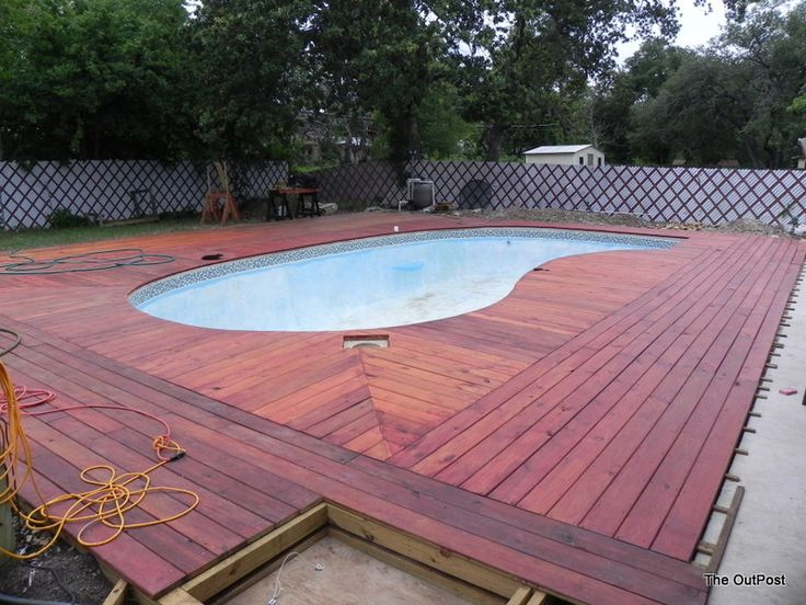 Pvc boards around inground pool time to hand paint the for In ground pool deck ideas
