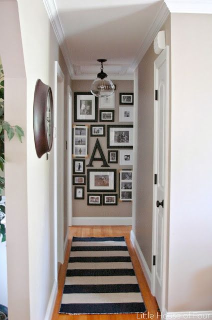 A boring hallway no longer!  A fun gallery wall, striped rug and beautiful glass pendant have transformed this basic hallway.