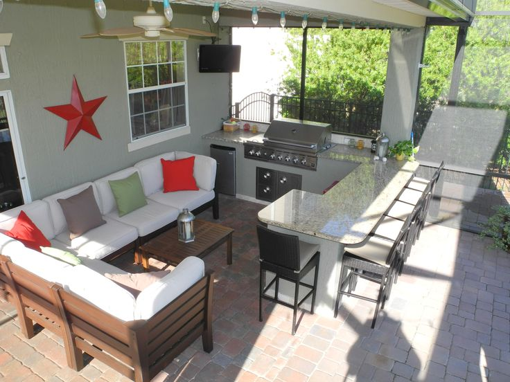 Combine your casual seating area with your outdoor kitchen for the ultimate outdoor hang out. Designed and constructed by Creative Design Space, Fleming Island FL.