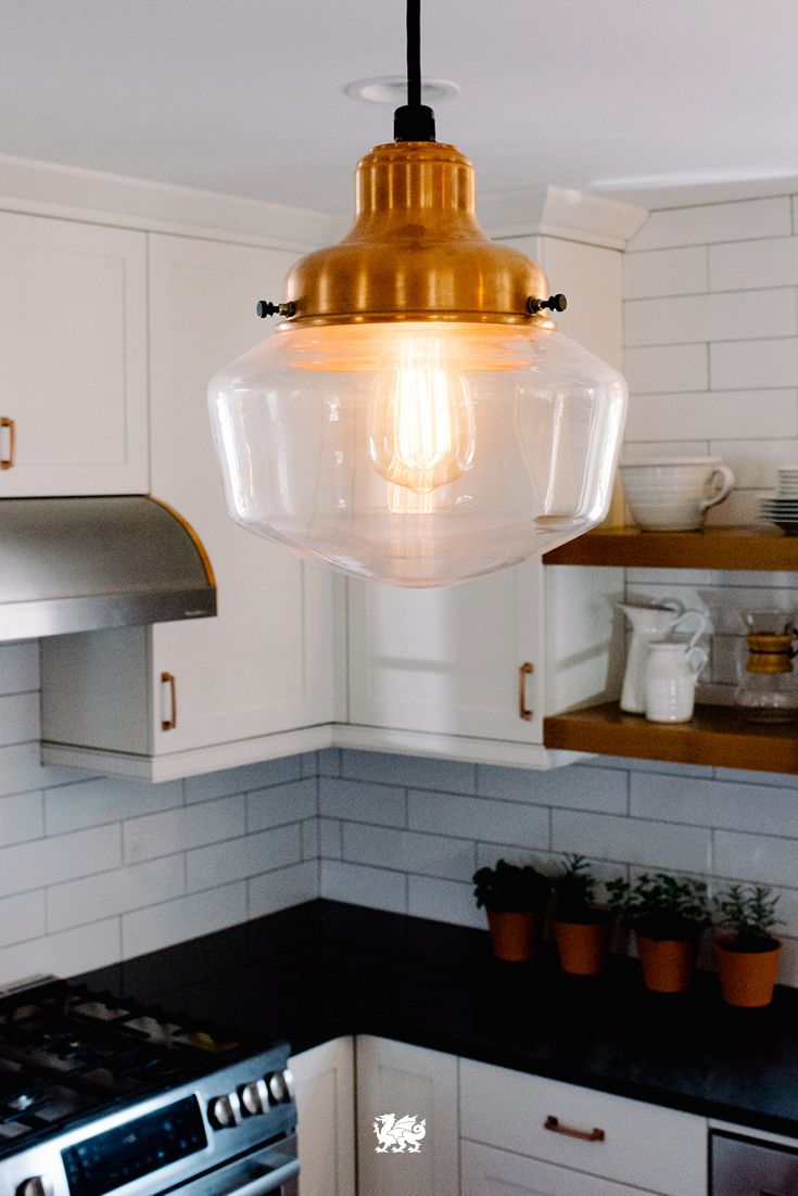 Everything old is new again in 2016. The vintage-meets-modern look of exposed bulbs and hanging wiring makes a comeback in kitchen renovations. [Featured Design: Fieldstone™]
