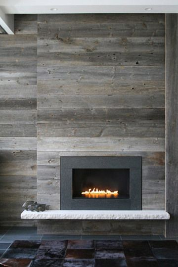 Modern rustic fireplace wall --Reclaimed Wood - BEAUTIFUL  We love the look of weathered wood, especially if it has a history. Flooring designer Ebony and Co has a line of unmilled barnwood that's been recovered from 150-year-old American barns scheduled for demolition, and these photos give just a glimpse into the wood's reuse potential.