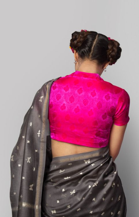 Shocking pink blouse with a dark grey sari - great color combo