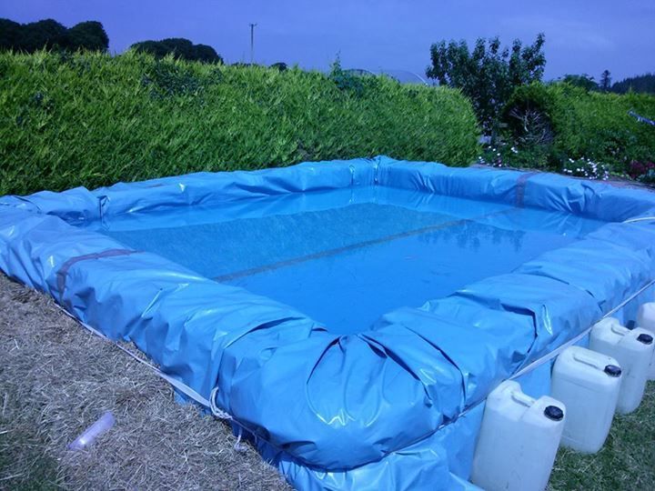 Temporary Swimming Pool   Made With Straw Bales
