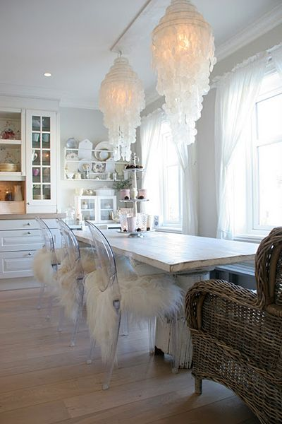 Gotta use my capiz shell chandelier somewhere. Like the table, but maybe a large round farm table with one wider around capiz shell chandelier.Would use all wicker chairs and lighten the look with large white plush cushions. People could then sit longer and better enjoy each others company.The windows in a natural linen.