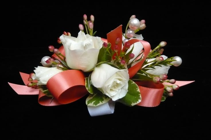 White spray roses and waxflower on coral ribbon on a velcro wristlet (perfect for a small girl)  wrist #corsage for #prom by Emil J Nagengast Florist in Albany, NY.