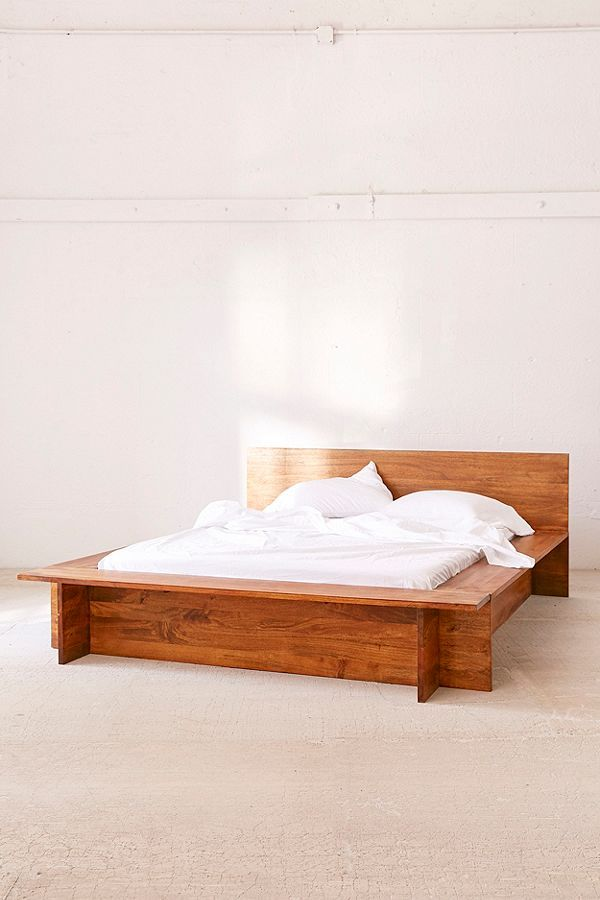 I think we found a winner! A wooden bed that can also house books
