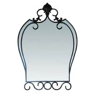 Showcasing A Scrolling Wrought Iron Frame And Heraldic Shield Inspired Silhouette This Beautiful Wall Mirror Brims With Sophisticated Appeal