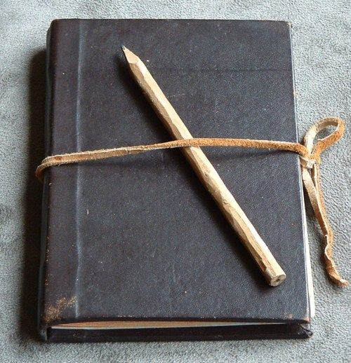 Black journal with hand sharpened pen.