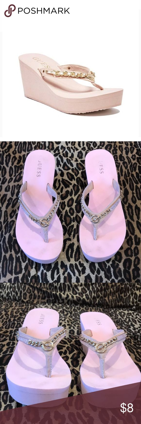 Guess wedge pink flip flops size 8 Guess wedge pink flip flops.  These pink  wedges look great on.  The strap is adorned with gold metal chains, the Guess logo in pink and crystals.  Size 8.  Good condition with plenty of life left. Guess Shoes Wedges