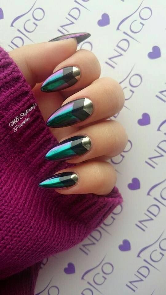 shape nail in almond/stiletto shape. paint base coat. divide nail in three triangle shape with nail tape. paint holo color in the 1st third of the nail. black in the 2nd third. gold in the last section. remove tape before it dries. paint top coat. let dry.