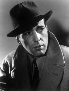 All men of mystery wear their collars up. Before Cumberbatch and the Belstaff coat, there was Bogart in his camel coat. Casablanca (1942). #oldhollywood #classichollywood #bogart #oldmovies