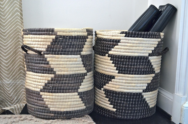 Maize Woven Storage Baskets by onestorybuilding- a lot of studios use baskets like this for mat rentals (vs member mat storage)