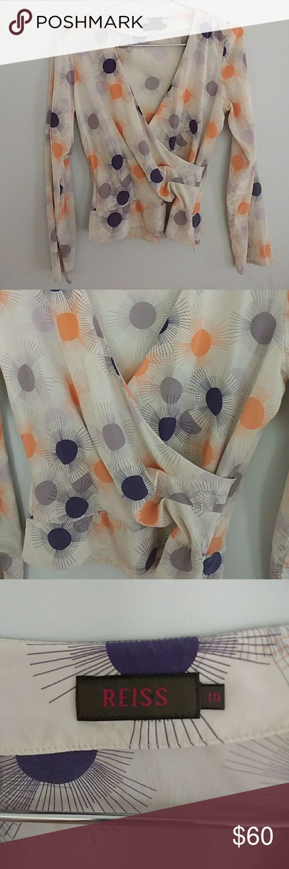 Reiss, silk blouse Reiss, silk off white with navy, light and medium purple color and orange sherbet color sun  pattern, faux wrap leads to side zipper, sleeves fall just past wrist, fits like an 8. Reiss Tops Blouses