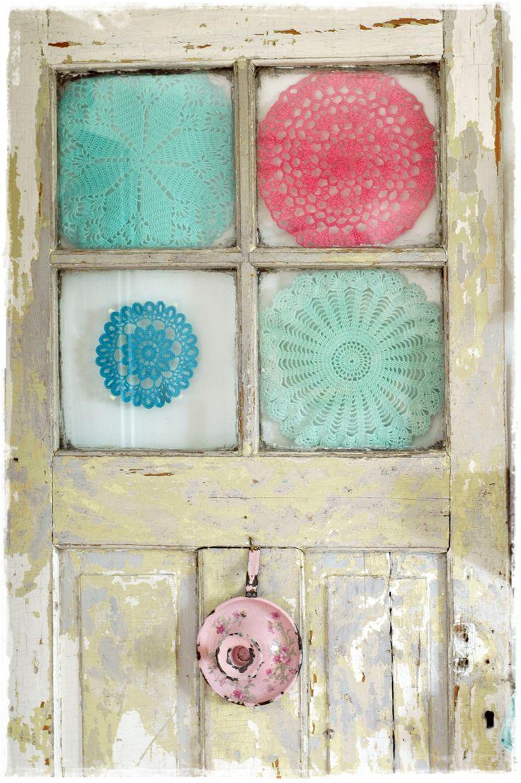 old crochet doily in an old door.                        Talleres Bordar Vigo