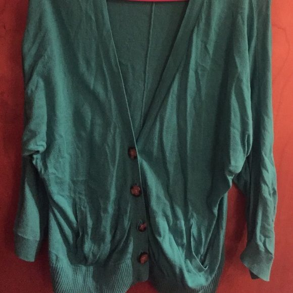 Turquoise cardigan! Super cute turquoise cardigan. Only flaw is the cracked button! Tops