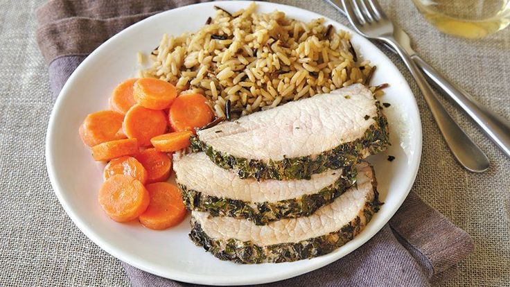 pork loin roast is coated with a medley of fresh herbs and roasted ...