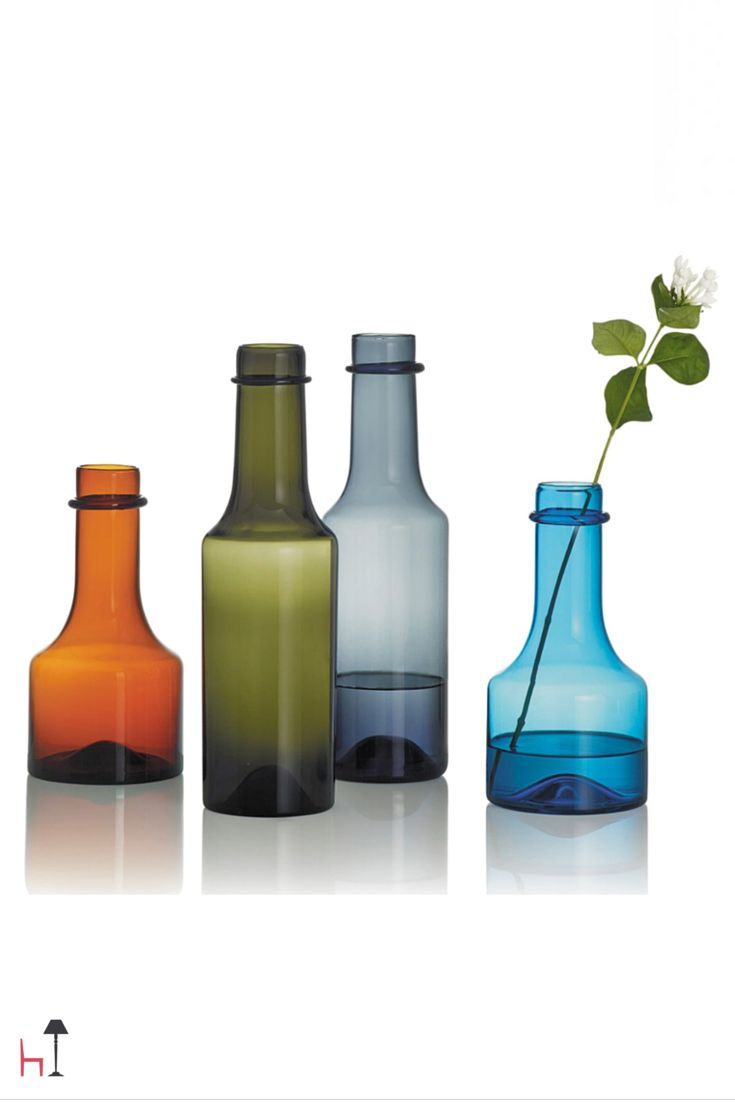 The bottle makes for a beautiful interior design element and art object that also works well as a carafe or vase for a single flower.