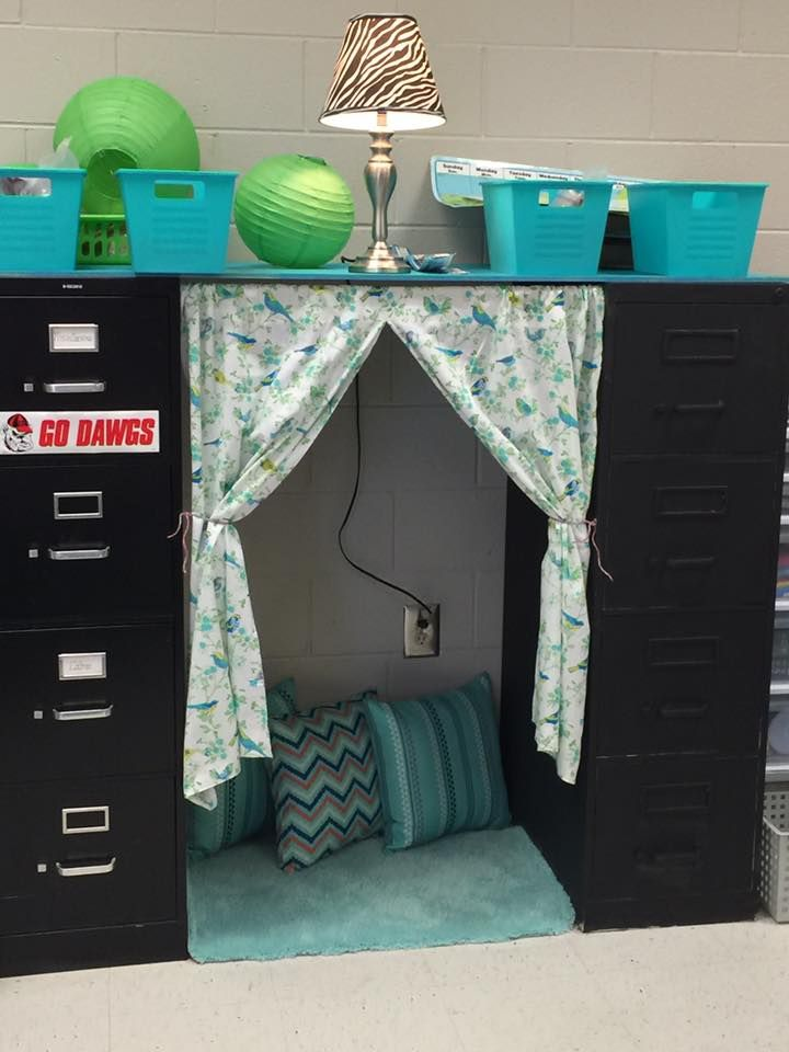 reading nook between filing cabinets or may use it to create a storage space and cover up with material