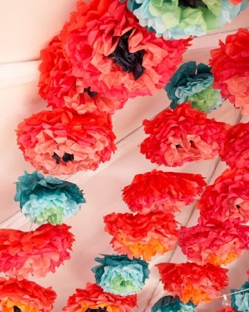 350 DIY paper blooms in five color combinations completely transformed this simple white reception tent