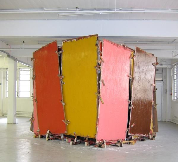 Phyllida Barlow is a pioneering English artist. Her sculptural installations are characterised by their large scale, often made quickly in the same place that they are to be shown and with materials that are subsequently recycled for future use. Their rough appearance conveys the urgency with which they are produced. In addition to being a practising Read more