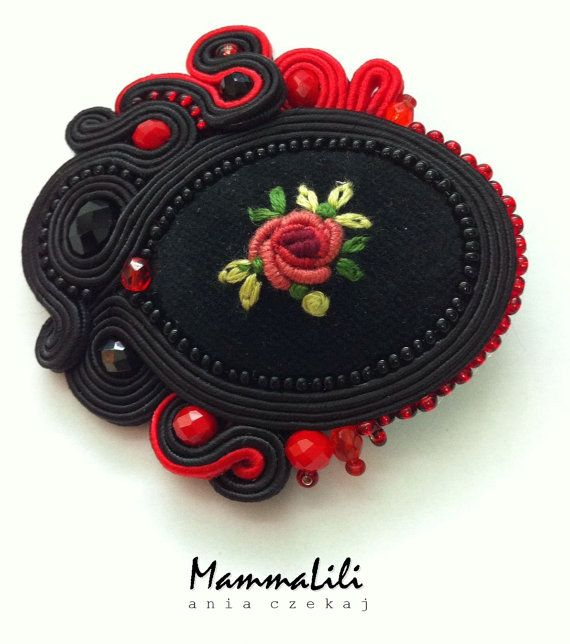 Elegant, unique, unique brooch handmade with the utmost care. The central point of a rose on a black velvet made embroidery. The whole is surrounded by