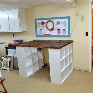 DIY knock off PB craft table for sewing room. 2 bookshelves with 2X6 boards as top...wonder about how level top is for cutting mat? may want to do plywood or something instead