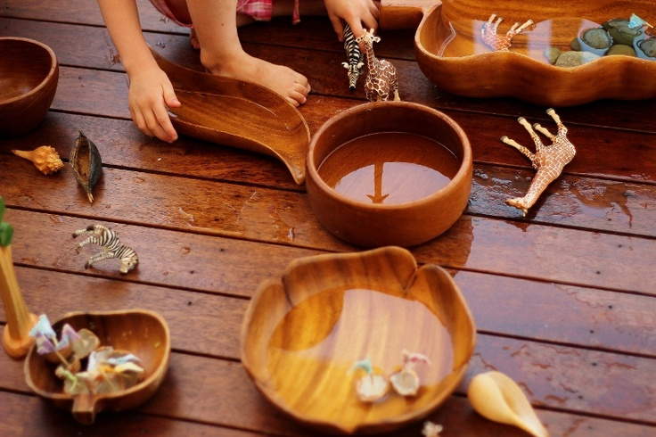 Water play and wooden bowls.... love 'em! I also use them in our outdoor kitchen.  They are beautiful, last for ever.