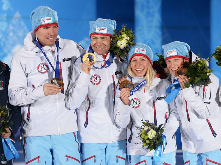 DAY 13: (L-R) Gold medalists Emil Hegle Svendsen, Ole Einar Bjoerndalen, Tiril Eckhoff and Tora Berger of Norway during the medal ceremony for Biathlon 2x6km Women + 2x7.5 km Men Mixed Relay http://sports.yahoo.com/olympics