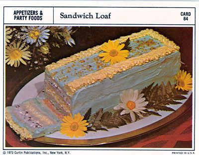 that's a sandwich loaf made with salmon, ham, chipped beef, olives, hard boiled eggs and walnuts - I'd be blue too :((