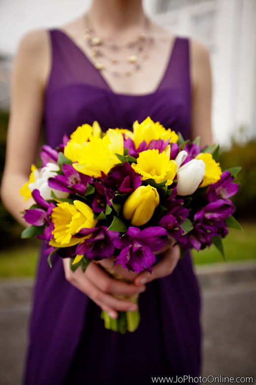 Bridesmaid's bouquet composed of yellow tulips, plum alstromeria lilies and daffodils. Created by Lisa Foster Floral Design.